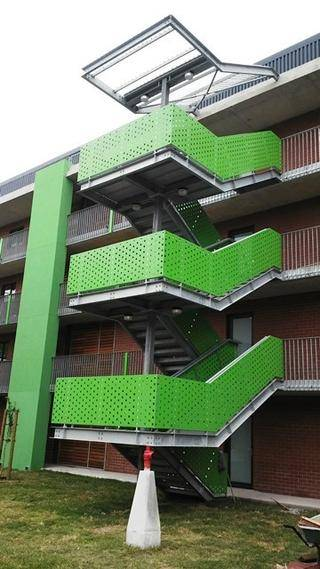 GALVANISED STAIRCASE WITH POWDER COATED PUNCHED ALUMINIUM CLADDED BALUSTRADES WITH ROOF STRUCTURE