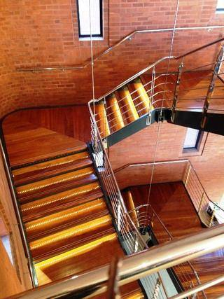 MILD STEEL POWDER COATED STAIRCASE WITH MAHOGANY STAIR TREADS